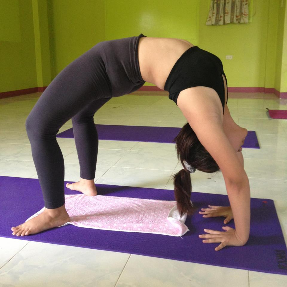 Chakrasana or wheel pose photo taken on my third week of yoga practice